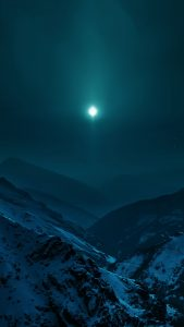 moon-shining-over-snowy-mountains-android-wallpaper
